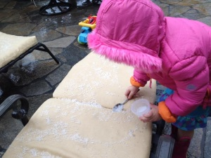 Young girl scoops up hail