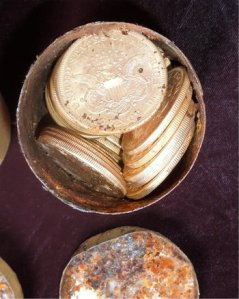 Saddle Ridge coins as found in decaying canister
