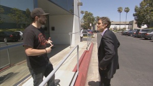 Dr. Oz confronts an employee outside TARR, Inc. headquarters in San Diego.