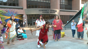 Supporters of the migrant children traveling to San Diego from Texas held a ritual outside a federal building.