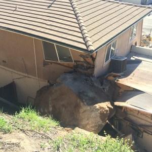 Large boulder smashes into corner of business in Alpine.