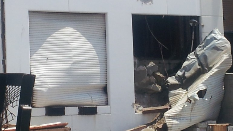 An exterior shot of an industrial building where an explosion happened inside.