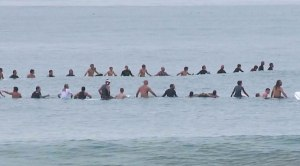 A paddle out honoring Logan Lipton brought hundreds to the beach in Oceanside Sunday.