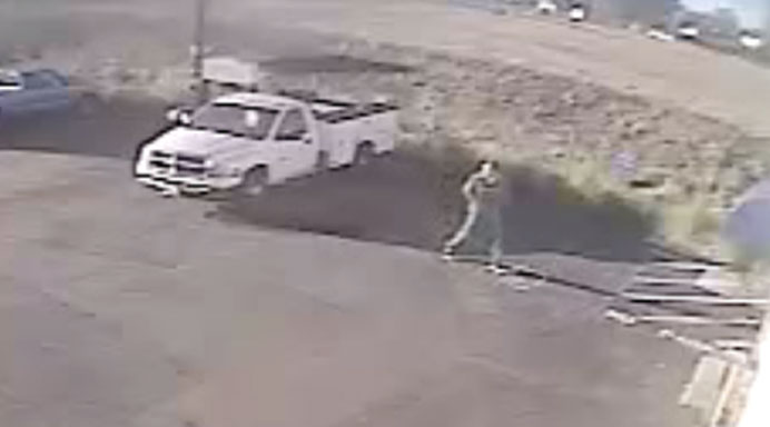 Truck thief seen walking around Wayne Miller's Mobile Tire business.