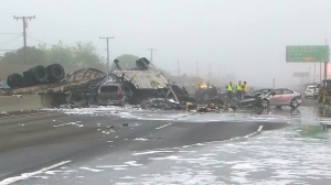 A fiery crash involving a big rig left three dead and five injured in the Commerce area on Feb. 27, 2016. (Credit: KTLA)