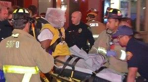 "Medics take injured Uber driver away from Gaslamp Quarter crash in restraints after he ""struggled"" with an officer, San Diego police said. (Credit: SDNV.tv)"