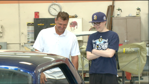 Trevor Hoffman and Bryce Newman check out his newly restored Mustang.