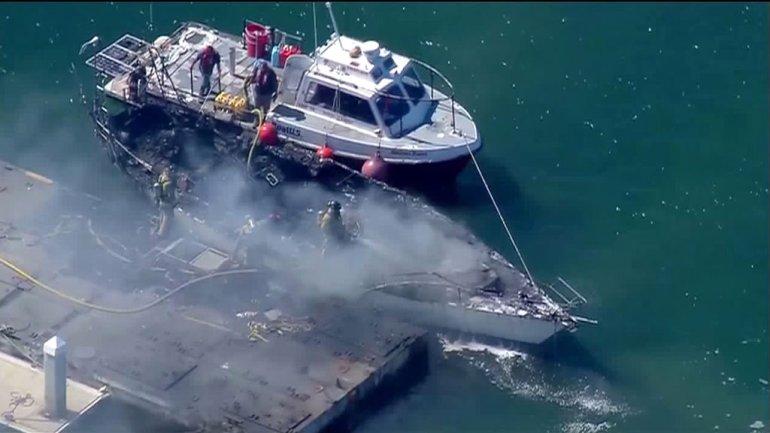 Sailboat Burns In Bay