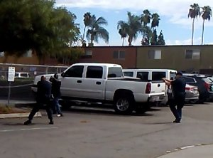 El Cajon police made public a still photo lifted from video taken at the scene showing a man in a shooting stance, although no weapon was recovered at the scene.
