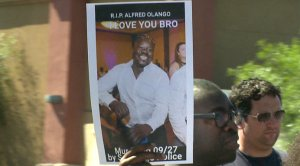 Alfred Olango sign held during rally