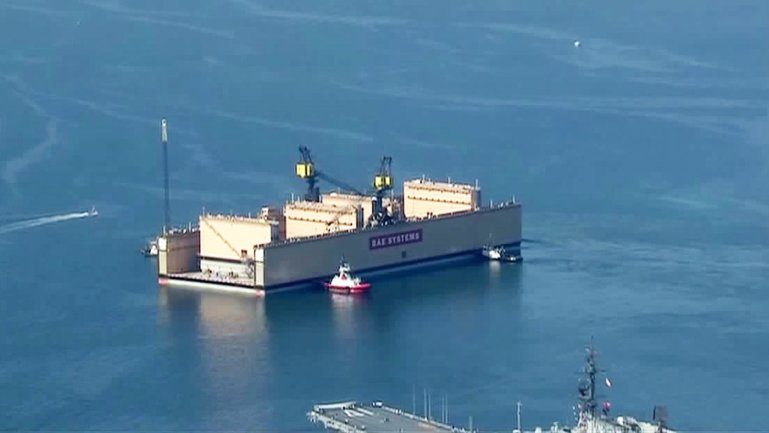 A huge dry dock arrived in San Diego Bay Thursday after a nine-week voyage from China.