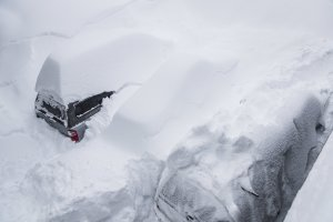 Vehicles are buried in snow at Mammoth Mountain on Jan. 23, 2017. (Credit: Peter Morning/ MMSA)