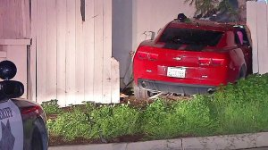 A red Camaro crashed into a home in El Cajon while trying to evade a sheriff's deputy.
