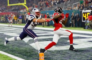 Tevin Coleman #26 of the Atlanta Falcons carries the ball past Rob Ninkovich #50 of the New England Patriots for a six yard touchdown during Super Bowl 51 at NRG Stadium on February 5, 2017 in Houston, Texas. (Getty Images)
