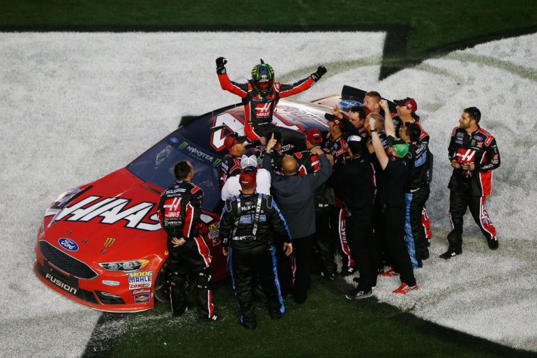 Kurt Busch, driver of the #41 Haas Automation/Monster Energy Ford, celebrates with his crew after winning the 59th Annual DAYTONA 500 at Daytona International Speedway on February 26, 2017 in Daytona Beach.  (Getty Images)