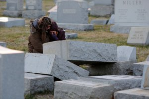 Melanie Steinhardt comforts Becca Richman at the Jewish Mount Carmel Cemetery in Philadelphia. Police say more than 100 tombstones were vandalized a week after a Jewish cemetery in St. Louis was desecrated. (Getty Images)