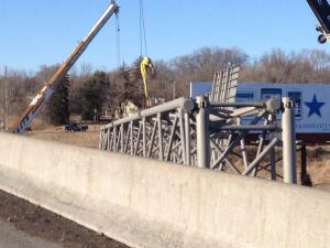 Traffic crews had to remove an overhead sign after it was struck on Tuesday, Feb. 18. (Photo: Eric Burke-WDAF-TV)