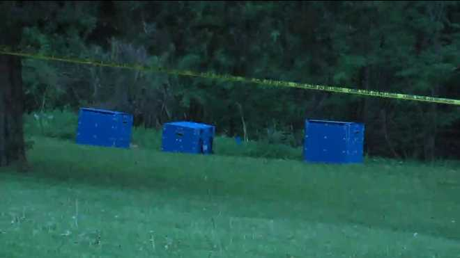 The property in Sedalia where authorities searched for more body parts after finding decomposed parts in a bin near a trailer.