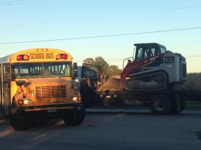 A school bus and a truck collided on Monday afternoon, sending 13 students to hospitals, two with serious injuries. (Photo: Molly Balkenbush/WDAF-TV)