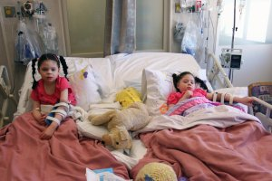Addi and Cassi recuperate at Children's Hospital, Oakland.