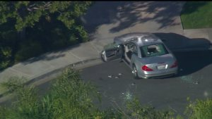 A car with shattered windows was seen outside a Scripps Ranch home on Feb. 10, 2105. (Credit: CBS8)