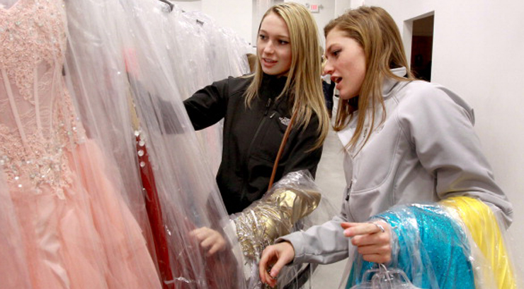 PEABODY, MA - JANUARY 18: Sisters Deirdre Somerville (left) and Melanie Somerville check out prom dresses at The Ultimate, a women's apparel store on Rt. 1 in Peabody, Mass. They are from Tewksbury and attend Tewksbury High School, where Deirdre is a junior and Melanie a senior. The store specializes in clothes for proms, social occasions, and evening wear. (Photo by John Blanding/The Boston Globe via Getty Images)