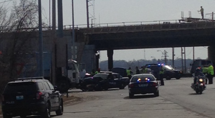 A police car smashed into a truck while in pursuit of a chase.