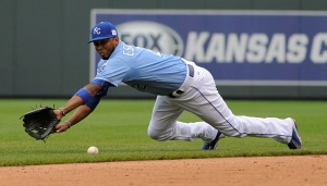 A ball hit by Jhonny Peralta of the St. Louis Cardinals gets past Alcides Escobar #2 of the Kansas City Royals in the eighth inning at Kauffman Stadium on May 24, 2015 in Kansas City, Missouri. (Photo by Ed Zurga/Getty Images)