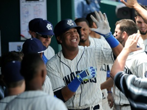 KANSAS CITY, MO - MAY 17:  Salvador Perez #13 of the Kansas City Royals celebrates his home run with teammates in the second inning against the New York Yankees at Kauffman Stadium on May 17, 2015 in Kansas City, Missouri. (Photo by Ed Zurga/Getty Images)
