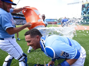 KANSAS CITY, MO - JUNE 7:  Salvador Perez #13 of the Kansas City Royals is doused with water by Drew Butera and Jarrod Dyson as they celebrate a 4-3 win against the Texas Rangers at Kauffman Stadium on June 7, 2015 in Kansas City, Missouri. (Photo by Ed Zurga/Getty Images)