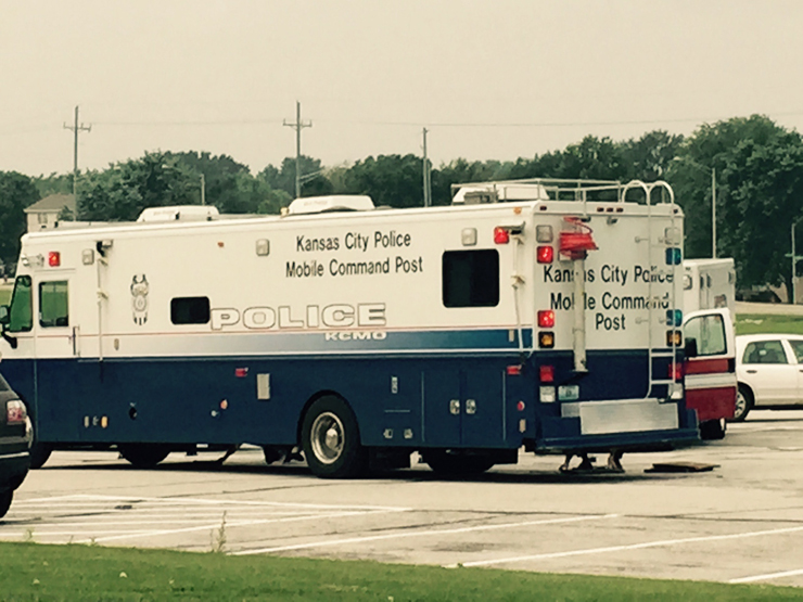KCPD mobile command looking for gunman who shot two people in the Northland -Staley area.