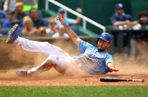 Eric Hosmer #35 of the Kansas City Royals slides safely into home plate to score during the game against the Tampa Bay Rays at Kauffman Stadium on July 9, 2015 in Kansas City, Missouri.  (Photo by Jamie Squire/Getty Images)