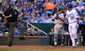Home plate umpire Gary Cederstrom calls the Kansas City Royals' Salvador Perez (13) out looking at strike three as Minnesota Twins catcher Kurt Suzuki heads for the dugout at the end of the fourth inning on Thursday, July 2, 2015, at Kauffman Stadium in Kansas City, Mo. (John Sleezer/Kansas City Star/TNS via Getty Images)