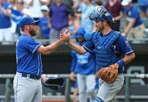 Greg Holland #56 of the Kansas City Royals (L) is congratulated by Drew Butera #9 after a win over the Chicago White Sox at U.S. Cellular Field on July 17, 2015 in Chicago, Illinois. The Royals defeated the White Sox 4-2.  (Photo by Jonathan Daniel/Getty Images)