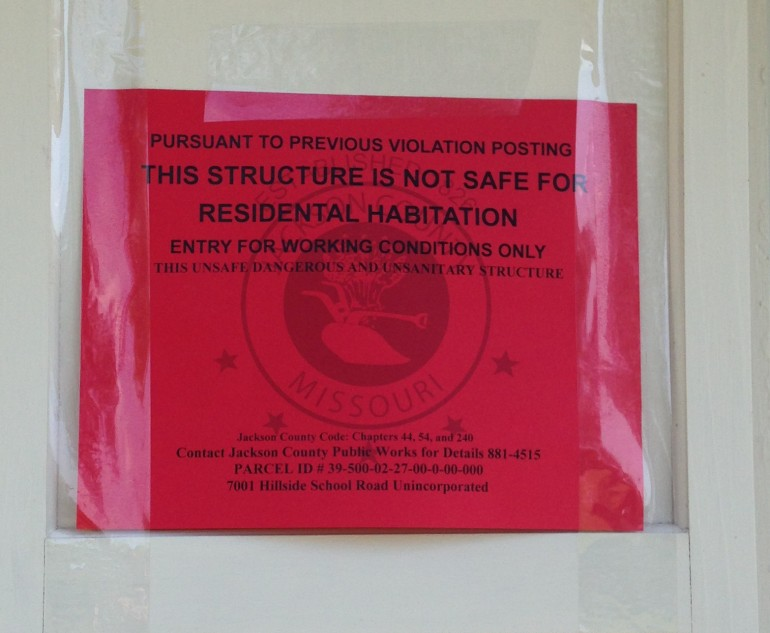 This is a notice that was left on the home where the dogs were found.