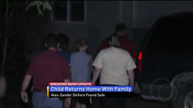 Family walks Alex-Zander inside his father's home.