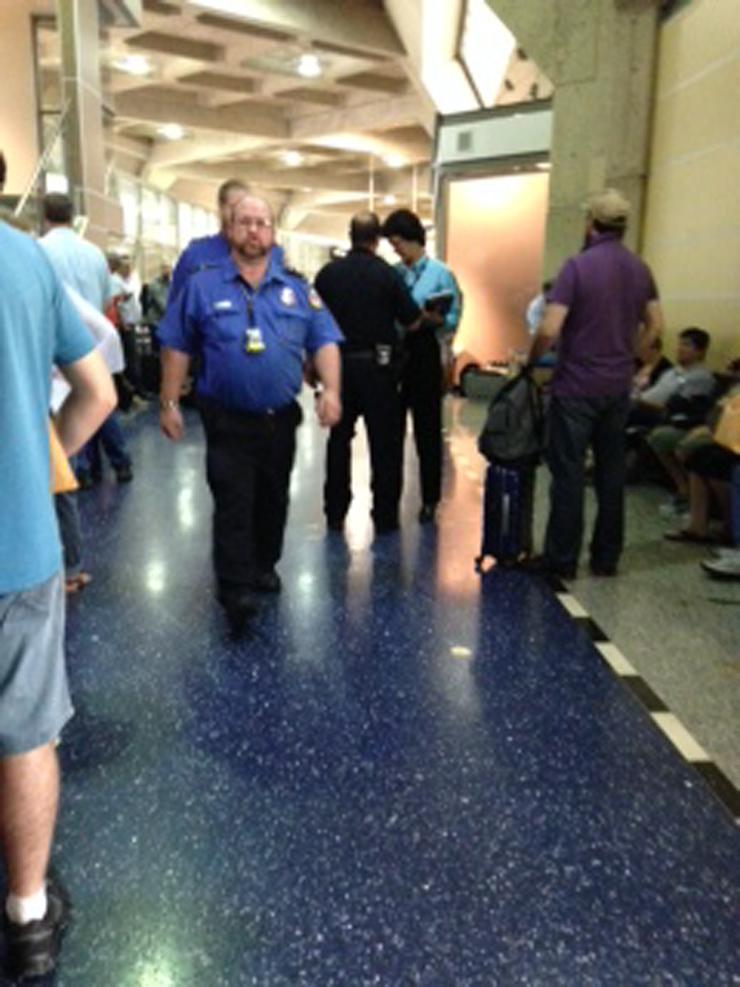 KCI Terminal C. Passengers wait as authorities investigate person exhibiting suspicious behavior.