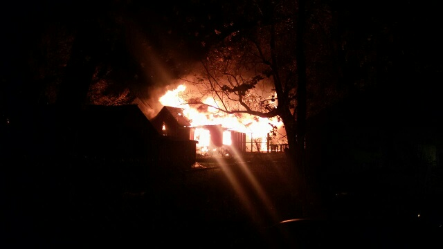 Firefighters are one the scene of a house fire that destroyed one home and quickly spread to another Thursday morning.