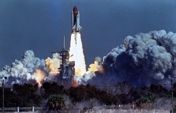 US space shuttle Challenger lifts off 28 January 1986 from a launch pad at Kennedy Space Center, 72 seconds before its explosion killing it crew of seven. Challenger was 72 seconds into its flight, travelling at nearly 2,000 mph at a height of ten miles, when it was suddenly envelope in a red, orange and white fireball as thousands of tons of liquid hydrogen and oxygen fuel exploded. AFP PHOTO NASA (Photo credit should read BOB PEARSON/AFP/Getty Images)