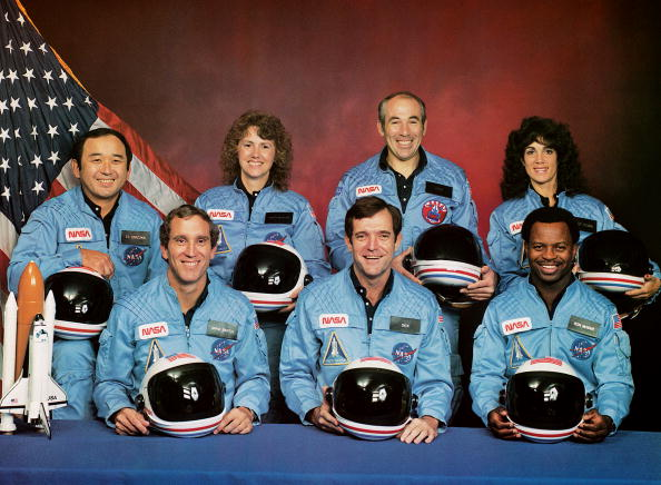 circa 1985:  The crew of the disastrous STS 51-L mission: (back row, left to right) Ellison S Onizuka, Sharon Christa McAuliffe, Gregory B Jarvis, Judith A Resnik, (front row, left to right) Michael J Smith, Francis R Scobee and Ronald E McNair. All seven were killed when the Challenger shuttle exploded during take-off on 28th January 1986.  (Photo by NASA/Space Frontiers/Getty Images)