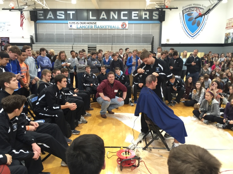 Shawnee Mission East varsity boys' basketball Coach Shawn Hair shaved his head on Thursday to bring awareness for pediatric cancer.