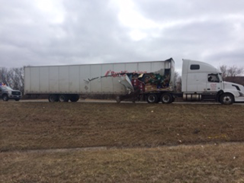 Damage to the semi that side-swiped the tour bus on I-70 near Adams Dairy Parkway.