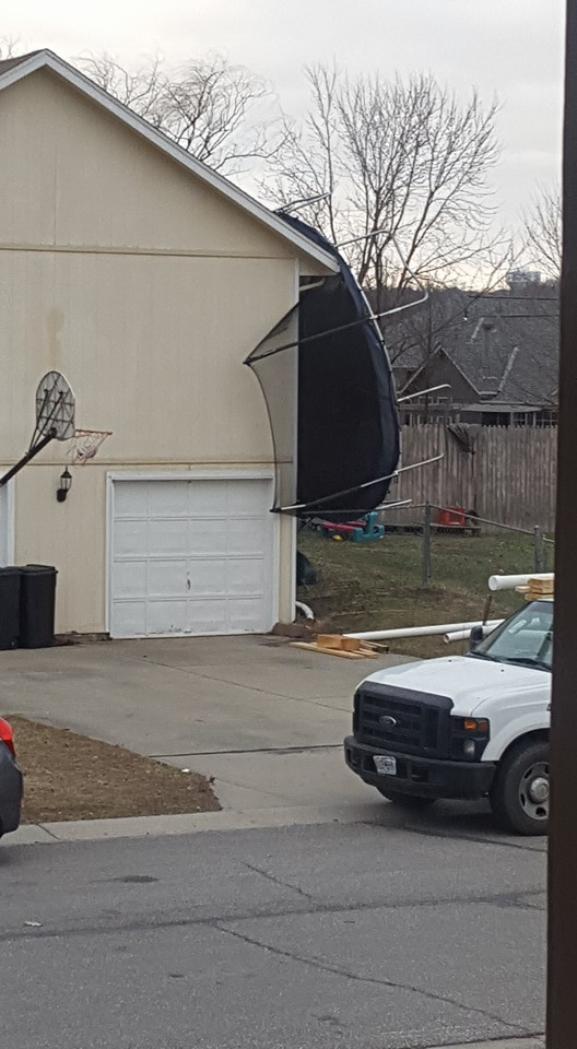 The strong winds blew a trampoline into the side of a home early Monday morning. FOX 4 viewer Bryon Gillespie says the trampoline is stuck in the roof of this Grain Valley home.