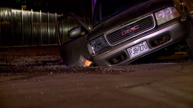 The woman was was driving the SUV that fell into a hole caused by a water main break says she wishes there would have been some kind of warning for drivers.