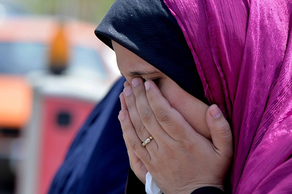 CAIRO, EGYPT - MAY 19: A relative of passenger onboard missing EgyptAir flight MS804 cries at Cairo International Airport as she tries to receive information in Cairo, Egypt on May 19, 2016. Airliner disappeared after entering the Egyptian airspace during its flight from Paris to Cairo. (Photo by Ala Ahmed/Anadolu Agency/Getty Images)
