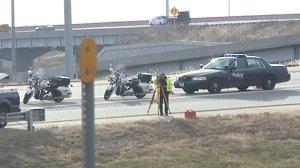 Police investigate the crash scene where Harrison was found.