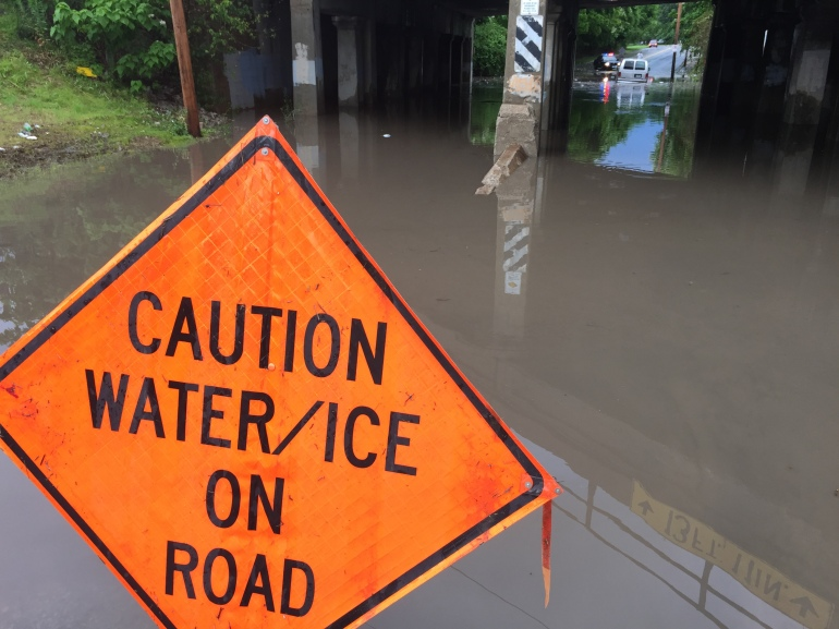 Water is covering the roadway at 9th and Hardesty after a flash flood Tuesday, May 23.