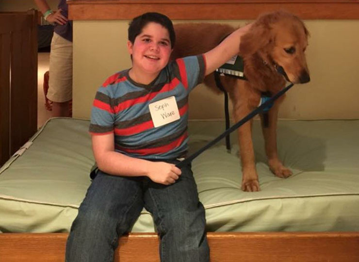 Presley the service dog is always at her owner's side, which is why she earned a spot alongside him in his middle-school yearbook. The goldendoodle accompanies 14-year-old Seph Ware to Good Hope Middle School in West Monroe, Louisiana, each day.