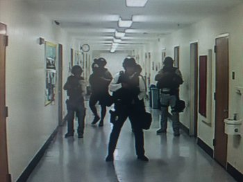 Screen grabs of UCLA's closed circuit cameras where you can see police searching hallways shortly before 1pmET.