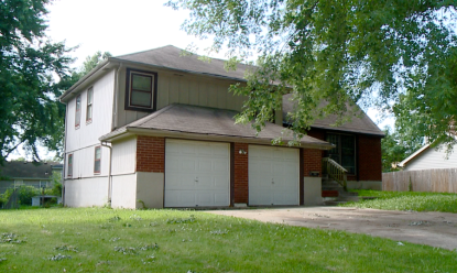 The home at 77th Terrace and Troost that police believe is where Long lived.